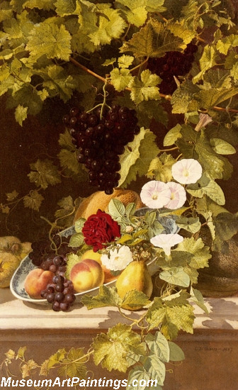 A Still Life With Fruit Flowers And A Vine